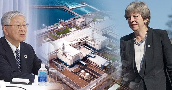 英国で原発の計画を進める日立製作所中西宏明会長と英国メイ首相