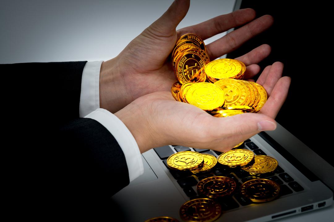 ビットコイン、「不安定すぎる通貨」を巡る心理ゲームの危うさ<br />
