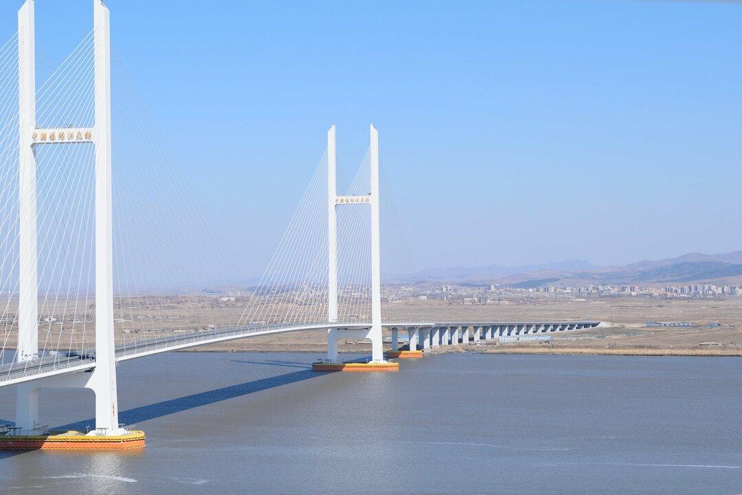 中朝を結ぶ大橋が開通へ、北朝鮮・新義州カジノタウン構想に潜む思惑